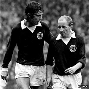 Joe Jordan and Jimmy Johnstone take the field against England at Hampden Park