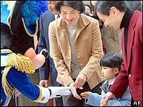 Japan's Princess Aiko, 2nd left, accompanied by her parents Crown Prince Naruhito, right, and Princess Masako as she is greeted by Mickey Mouse upon arrival at Tokyo DisneySea, Monday, March 13, 2006.