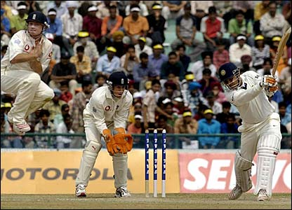 Virender Sehwag hits a four