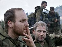 Israeli soldiers relax after returning from Lebanon after the truce