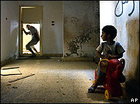 Lebanese boy watches his father enter their apartment in Sadikin, west of Tyre