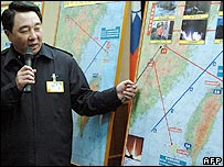 Taiwan's defence ministry spokesman Liou Chih-jein during a press conference at Taipei 07 March 2006, shows a map across the Strait