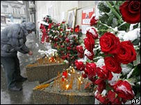 Mourners outside the Socialist Party headquarters in Belgrade