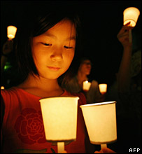 A Japanese girl at an anti-shrine vigil in Tokyo on Monday night