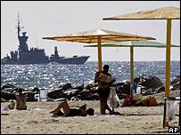 An Israeli military ship sails off the shore of Haifa, Israel
