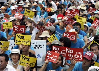 "South Korean protesters in Seoul, with signs reading: ""No, history distortion; Yes, East Asia peace."""