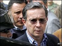 Colombian President Alvaro Uribe leaves the polling centre under heavy escort