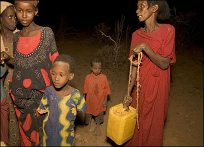 Family by the roadside, begging for water (Photo: Christian Aid / Mike Goldwater / Getty Images)