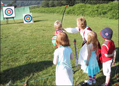 Ewan, Carys, Lewis and Morgan archery practice at the Margam Park Tapestry festival (Steve from Nottingham)