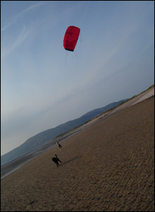 Tom Evans enjoying his kite on Deganwy Beach in North Wales, taken by Natasha Evans