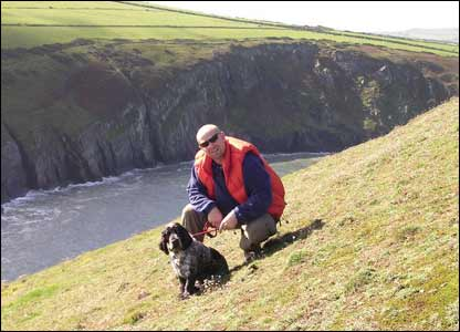 Chris and Dewi on an early morning stroll at Mwnt (Sara Francis)