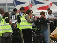 Passengers' bags being checked. File photo