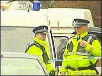 Officers with vans