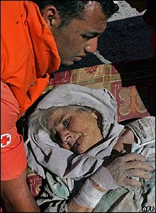 A Red Cross worker evacuates a wounded Lebanese elderly woman from Bint Jbeil - 14 August 2006