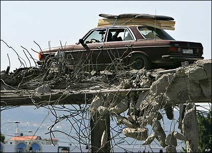 Car drives on damaged bridge at Naameh, south of Beirut - 15 August 2006