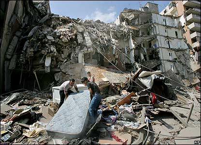 Family salvages a bed from their ruined home in Beirut - 15 August 2006