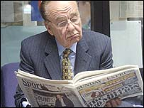 Rupert Murdoch reading a newspaper