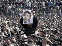 A supporter holds a pictures of President Ahmadinejad