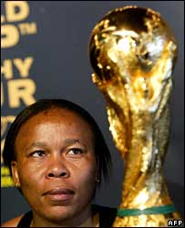 South African woman looks at World Cup trophy