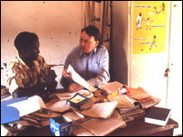 David Morgan shares some ideas with a teacher from KIMU Charitable School in Soba Camp. (Picture: Education Action)