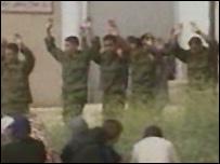 Palestinian prison guards surrendering at Jericho's jail