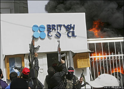 Gunmen outside the burning British Council