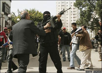 A masked gunman in Gaza City