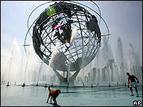 Man and dog keep cool at New York's Unisphere fountain during recent heat wave