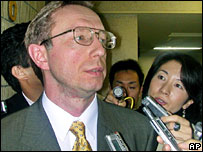 Acting Russian ambassador to Japan Mikhail Galuzin, is surrounded by reporters  in Tokyo - 16/8/06