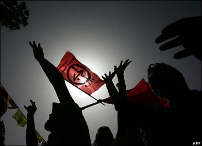 Supporters of the Popular Front for the Liberation Palestine hold up the PFLP red flag as they demonstrate at the Palestinian parliament in Gaza City
