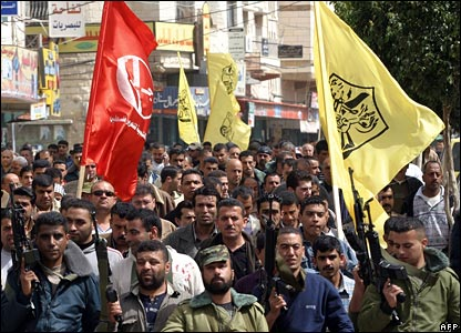 Armed members of the Popular Front for the Liberation of Palestine, which Mr Saadat heads, protest in Jenin