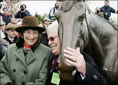 Owner Jim Lewis and Henrietta Knight pose for pictures with the new statue of Best Mate