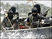 Armed militants in a boat