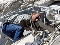 Lebanese man clambers through rubble in village of Aaitaroun, southern Lebanon