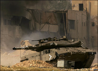 An Israeli tank rolls into position as the Palestinian jail compound