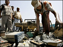 Iraqis inspect the blast site in Baghdad