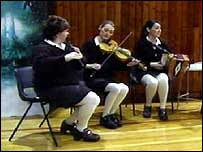 Pupils at St Louise's playing musical instruments