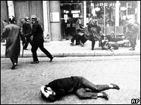 Demonstrator lies on the ground during clashes with police in Paris, 6 May 1968