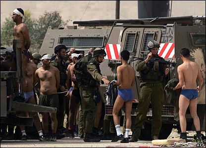Palestinian inmates and guard are detained by Israeli troops