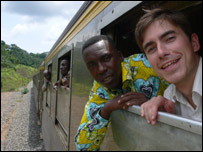 Simon with his guide, Linel Kwatsi, in Gabon, on one of the world's most expensive railway lines