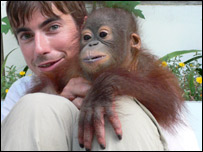 Simon with an orphaned orangutan in Borneo