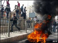 A tyre is burned as protesting Palestinians take to the streets of Ramallah