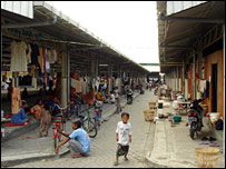 A little boy in the market place where people have been sheltering