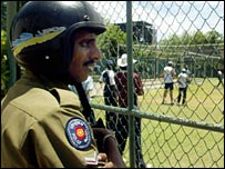 A Sri Lanka policeman guards cricket practice