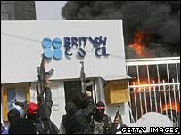 Gunmen outside the burning British Council in Gaza