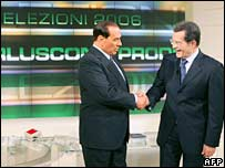 Italian Prime Minister Silvio Berlusconi (left) and opposition leader Romano Prodi shake hands before the debate