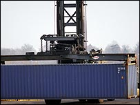 Forklift truck carrying container at US port