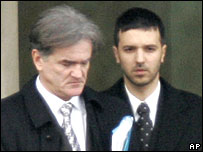 Milosevic's lawyer Zdenko Tomanovic and son Marko, at the morgue in The Hague