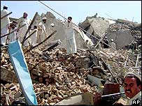 Tribesmen search for belongings from the rubble of their shops destroyed in fighting between Pakistani forces and militants in Miranshah