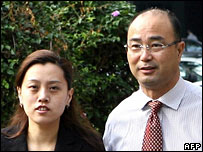 Former CAO chief Chen Jiulin and his wife outside Singapore court